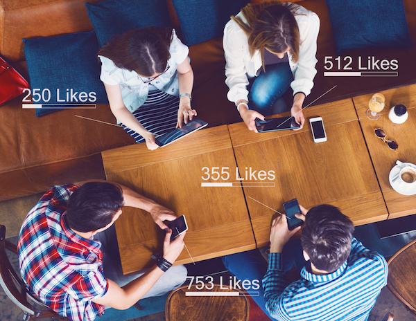 Group of young people sitting at a cafe, counting likes